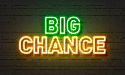 Big chance neon sign on brick wall background.