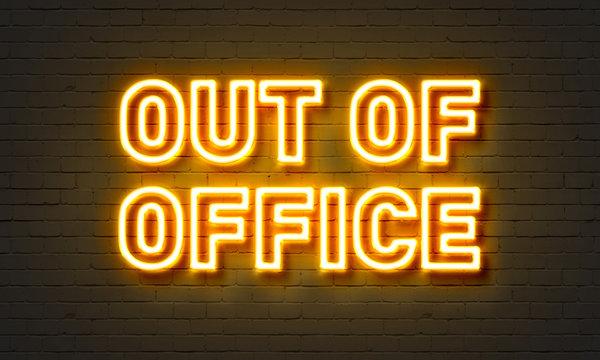 Out of office neon sign on brick wall background.