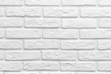 Abstract weathered texture stained old stucco light gray white brick wall background, grungy blocks...