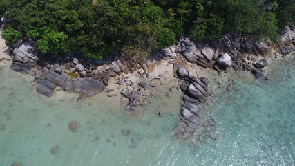 Aerial top view of sea, rocks and coastline of one of the beach in Phuket, Thailand
