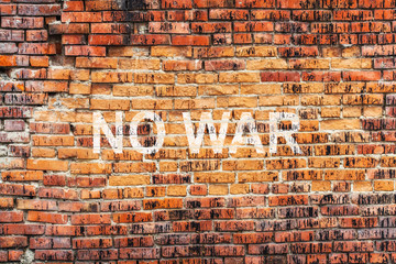 Text NO WAR on stained old orange brick wall texture background