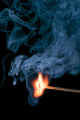 Stiking Match and Billowing Smoke