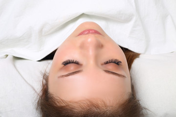 Eyelash Extension Procedure. Woman Eye with Long Eyelashes. Lashes, close up, selectve focus.