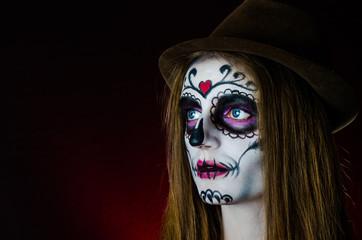 girl in a make-up posing in studio Halloween