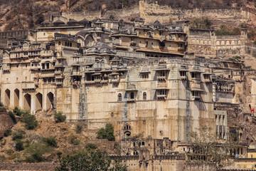 View of impressive Garh Palace nestled in the mountains, , Bundi, Rajasthan, India