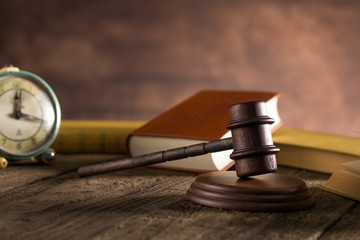 hammer judge, law theme, mallet of the judge,  wooden desk, books,