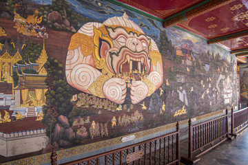 Thai mural paintings at Wat Phra Kaew. Scenes of Ramayana anciet Indian story are painted in the gallery along the temple's wall