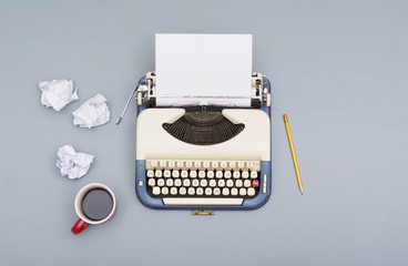 writers block concept. Retro typewriter with paper props