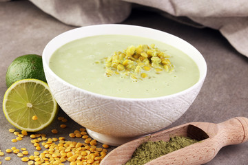 Lentil soup witch matcha and lime in a bowl for vegan, gluten free, allergy-friendly, clean eating and raw diet.