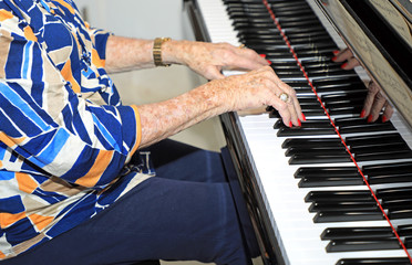 Elderly senior playing the piano at age 95.
