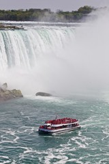 Beautiful isolated photo of a ship near amazing Niagara waterfall