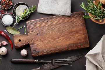 Cooking table with herbs, spices and utensils