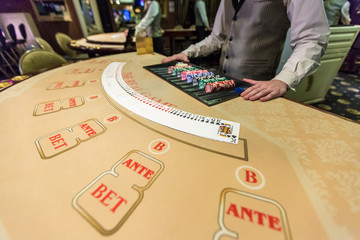 gambling chips and cards on a game table roulette