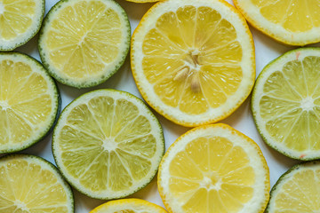 Citrus fruit background with sliced lemons and lime