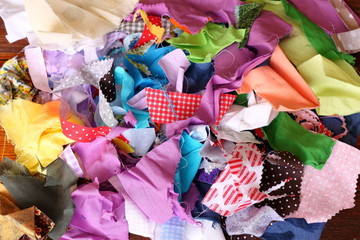 Pile piece of fabric scraps together into a colorful work of art