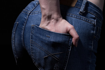 Buttocks and hand in jeans pocket