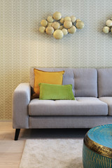 Couch detail in modern house with wall papper