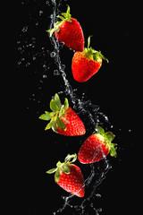Wall Mural - Strawberries in water splash