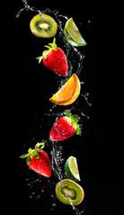 Wall Mural - Fresh fruits falling in water splash