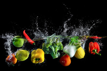 Vegetables splash in water