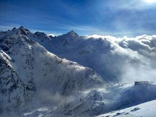 The snowy mountain slopes with bright sunshine