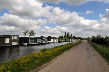Housing Boats on a tranquil natural spot in the river near Amsterdam, Netherlands