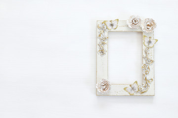 Vintage blank white photo frame