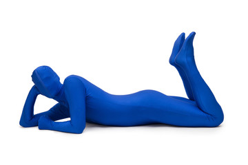 Mysterious blue man in costume lying on the floor