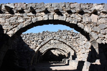 Stone arches of basalt rock in desert castle Qasr al Azraq in Jordan, Middle East