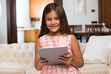 Smiling child using a tablet