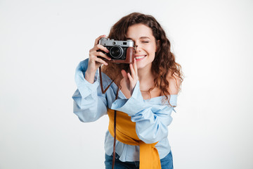 Close up portrait of a young attractive woman with camera