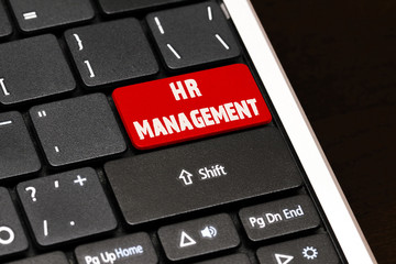 HR Management on Red Enter Button on black keyboard