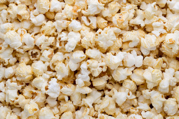 Popcorn background. Caramel sweet corn. Cinema snack.