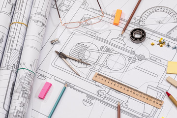 Workplace - technical project drawing with engineering tools. Construction background.
