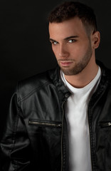 Attractive Man in Leather Jacket Over White Shirt