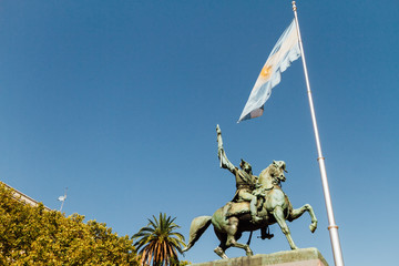 Statue of Manuel Belgrano and Argentine flag in the Plaza de Mayo of Buenos Aires