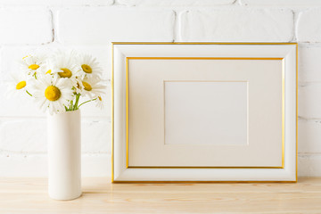 Gold decorated landscape frame mockup with daisy flower in vase
