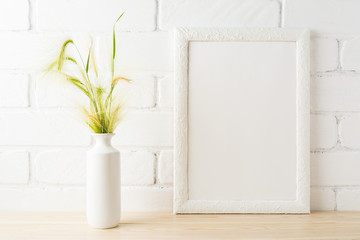 White frame mockup with yellow and green wild grass ears
