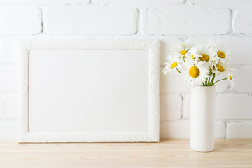 White landscape frame mockup with daisy flower in styled vase