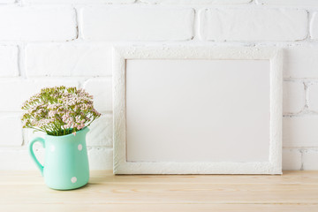White landscape frame mockup with soft pink flowers in pitcher