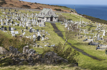Path through cemetery leading to the church of St. Tudno at Llandudno, Wales, UK