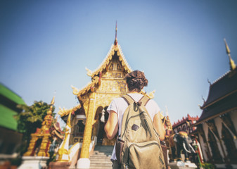 a young woman travel to Thailand, visiting the sights. Buddhist Thai temple in Chiang Mai