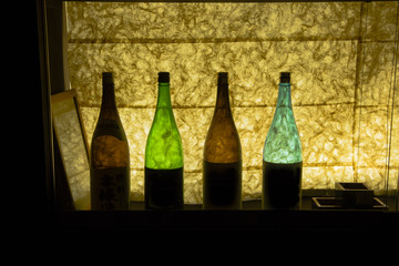 Backlit Colorful Glass Sake Bottles