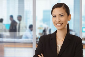 Smiling asian businesswoman in office