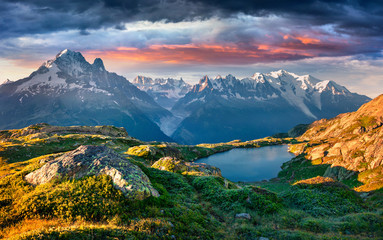Colorful summer sunrise on the Lac Blanc lake with Mont Blanc (Monte Bianco) on background. Wall mural