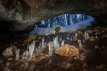 Cave with stalagmites of ice