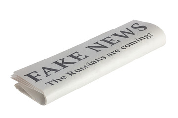 Newspaper with Headline of Fake News. The russians are coming! Isolated on White