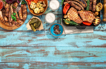 Various grilled food  on blue wooden table with copy space