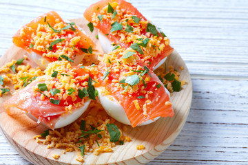Filled eggs with salmon pinchos tapa Spain