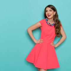 Laughing Beautiful Woman In Pink Mini Dress Looking Away